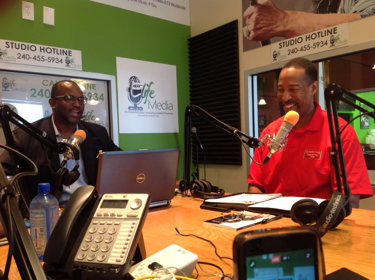 "Being interviewed on ""Peace in the Morning"" broadcast with Darius A. Stanton"